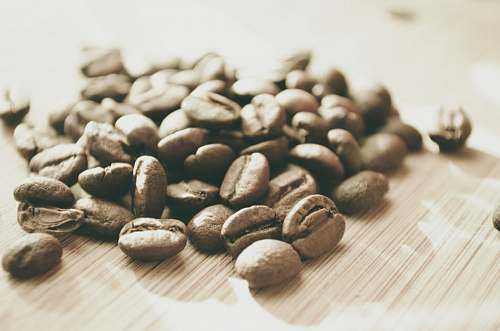 bean coffee beans on brown surface coffee beans