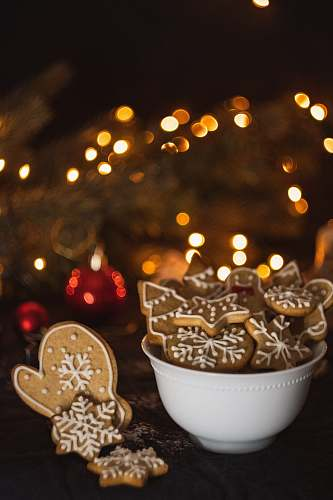 photo sweets cookies in bowl near Christmas tree confectionery free for commercial use images