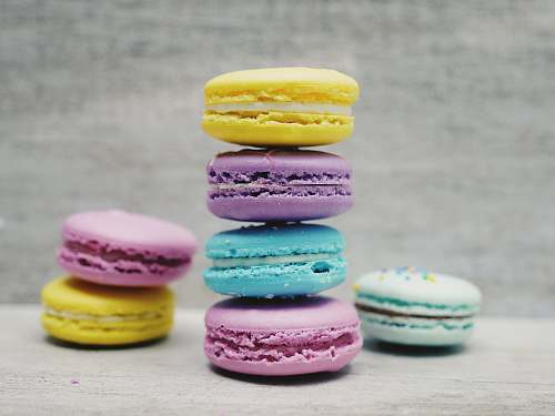 photo colorful four macarons balancing near two and one macarons colour free for commercial use images