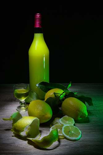 photo citrus fruit lemon fruits and yellow glass bottle fruit free for commercial use images