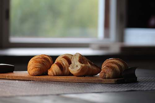 bread selective focus photography of four brown croissant breads croissant