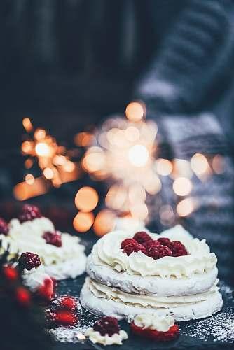 cake white icing-covered cake on black surface cream