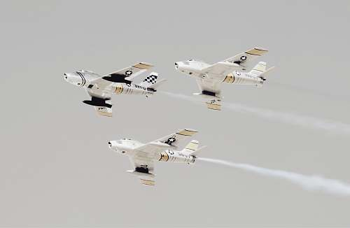 flight three white-and-black jet planes aircraft