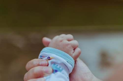 baby person holding baby's hand newborn