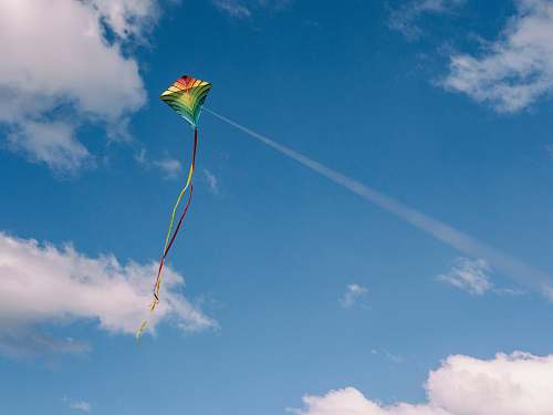 photo blue green and yellow kite on air cloud free for commercial use images