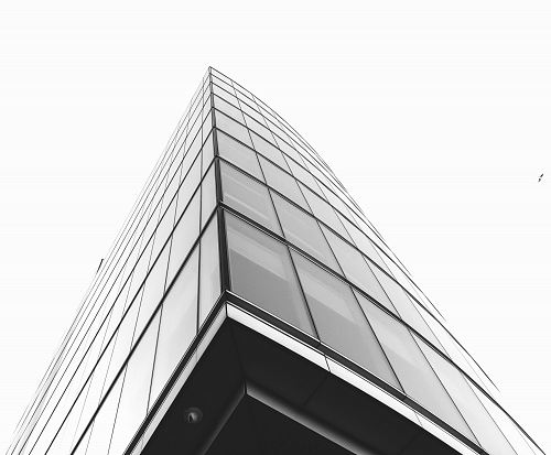 photo low angle photography of glass building under cloudy sky free for commercial use images
