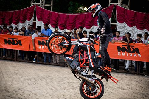 photo man doing tricks while riding on dirt bike free for commercial use images