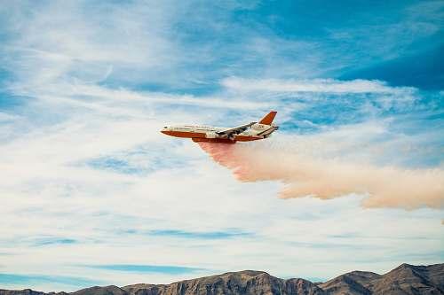 flight white plane spreading pink smoke airplane