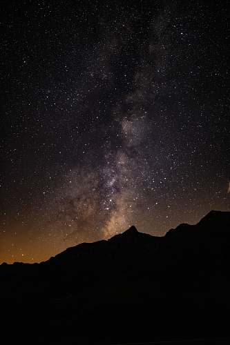 nature silhouette of mountain under starry sky outdoors