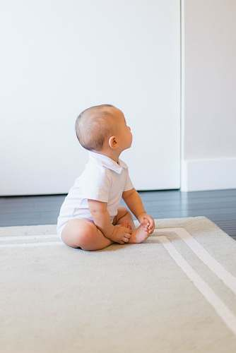 photo person baby sitting on beige rug human free for commercial use images
