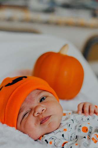 photo person baby wearing orange knit cap human free for commercial use images