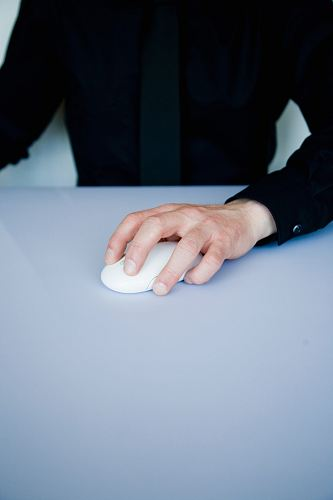 photo person holding white cordless computer mouse free for commercial use images