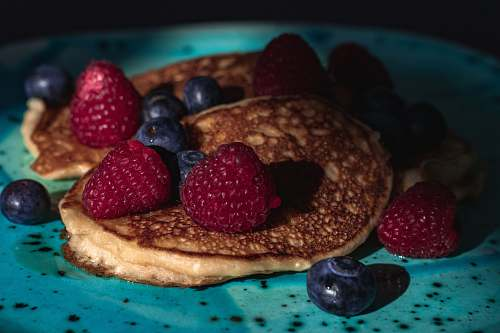 photo blueberry pancakes with raspberries and blueberries fruit free for commercial use images
