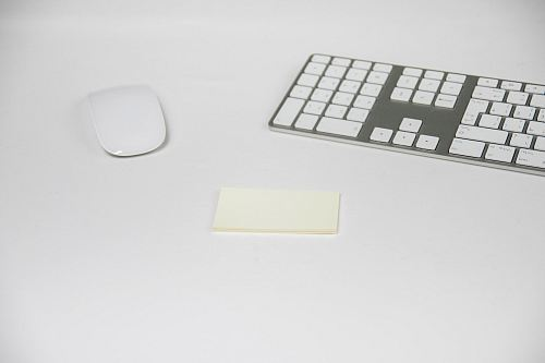 two white Apple Magic Mouse and Keyboard
