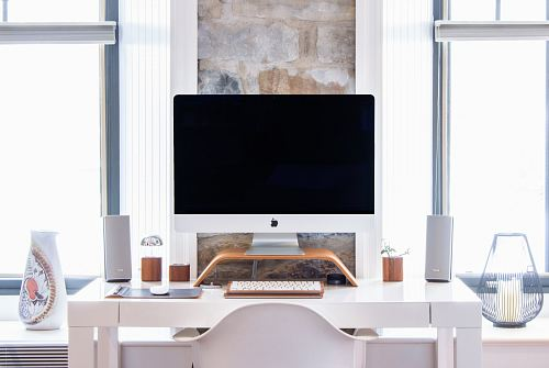 photo white iMac on top white desk free for commercial use images