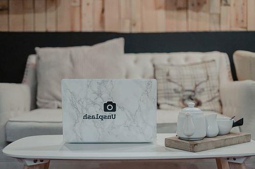 white teapot on white table