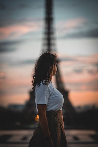 woman wearing white shirt in front of Eiffel Tower