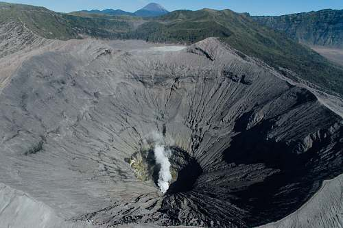 nature aerial photography of brown volcano peek outdoors