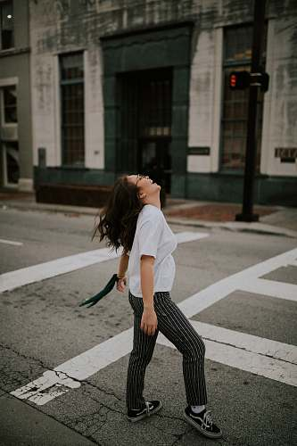 photo tarmac woman standing on road's pedestrian lane road free for commercial use images