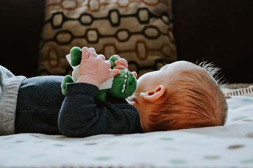photo kid baby lying on white bed child free for commercial use images