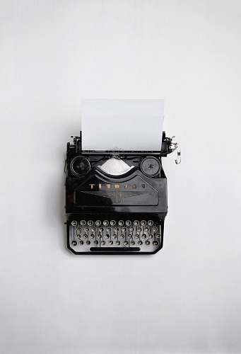 white black Fayorit typewriter with printer paper writing