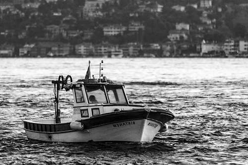 transportation grayscale photo of sailboat vehicle
