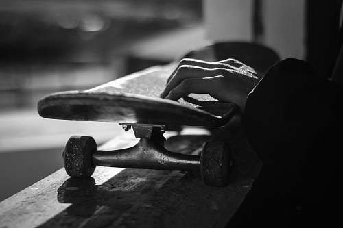 photo skateboard greyscale photography of skateboard person free for commercial use images