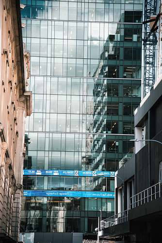 office building clear glass paneled high rise building architecture
