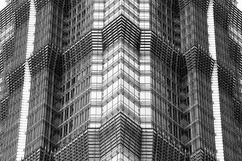 black-and-white high rise building urban