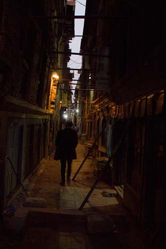 photo city man walking in the alley road free for commercial use images