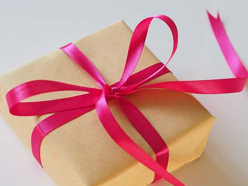 gift brown gift box with pink ribbon birthday
