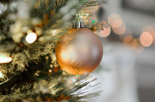 ornament closeup photography of brown Christmas bauble holiday