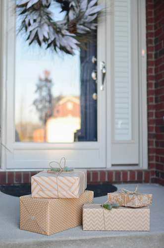 photo gift four brown gift boxes near white door porch free for commercial use images