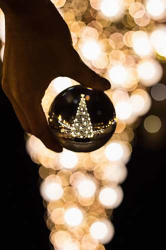 photo crystal person holding glass bauble lamp free for commercial use images