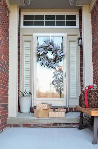window wreath hanging on full-lite door of house holiday