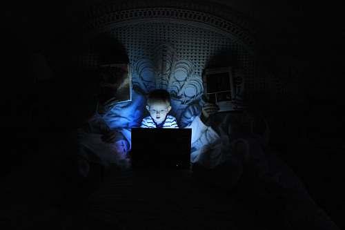 laptop boy playing at laptop inside room kid