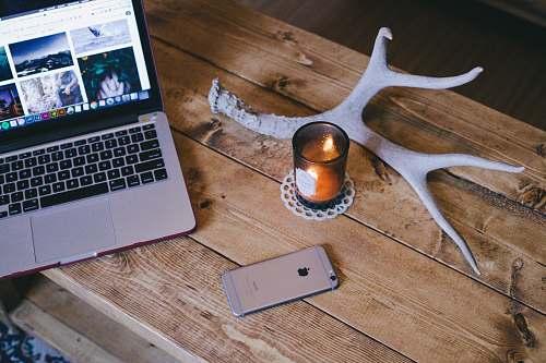 laptop MacBook Pro beside space gray iPhone 6 electronics