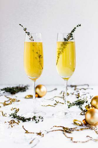 photo cocktail shallow focus photography of champagne glasses surrounded by gold baubles beverage free for commercial use images