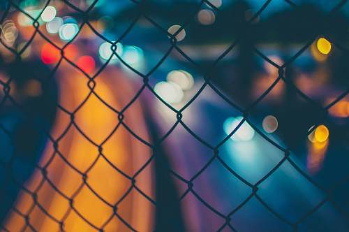 photo light chain link fence with bokeh lights night free for commercial use images