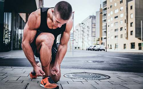 photo people man tying his shoes sport free for commercial use images