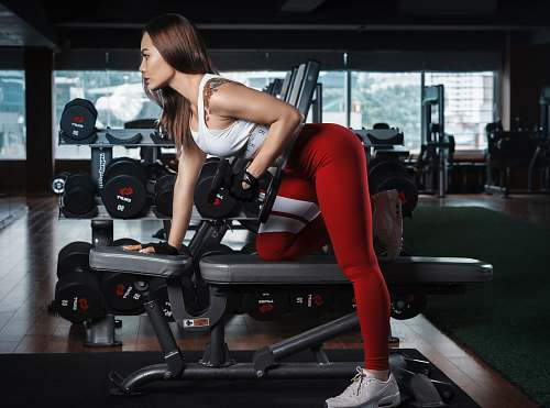 photo sport woman using dumbbells human free for commercial use images