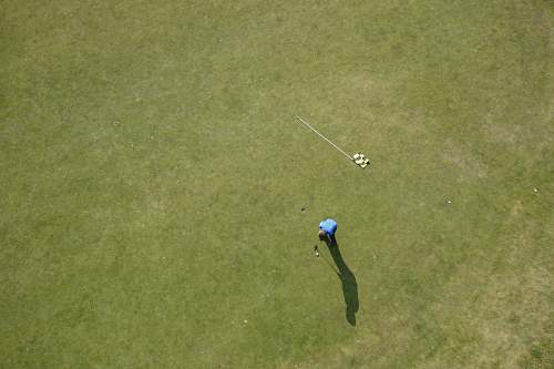 sport aerial photo of man playing golf sports