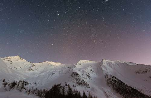 photo mountain white mountain during nighttime backgrounds free for commercial use images