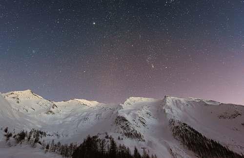 mountain white mountain during nighttime backgrounds