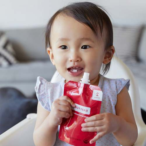 person baby drinking juice pack baby