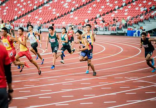 photo person runners on field running track free for commercial use images