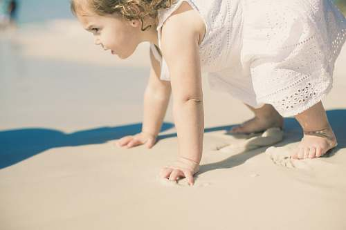 person toddler's playing on sea shore people