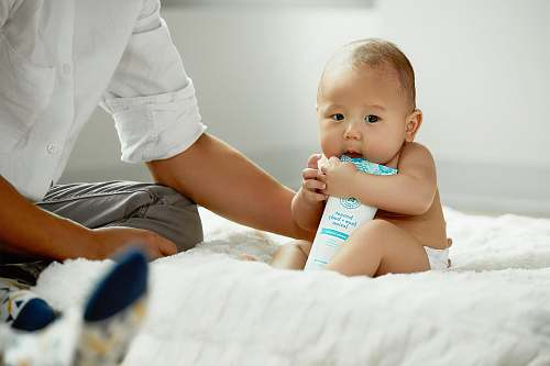 photo person topless baby hugging white soft-tube baby free for commercial use images