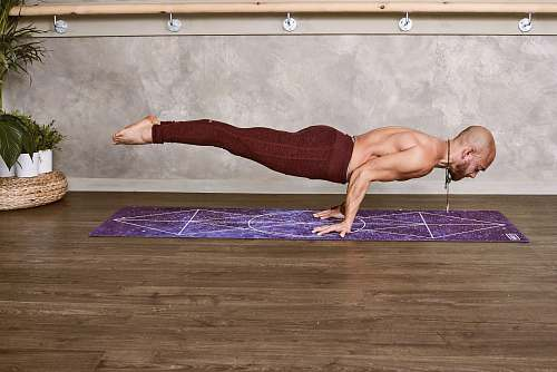 photo fitness woman push-up his whole body on purple mat exercise free for commercial use images