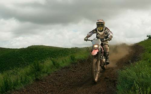 sport rule of thirds photography of white dirt bike motocross